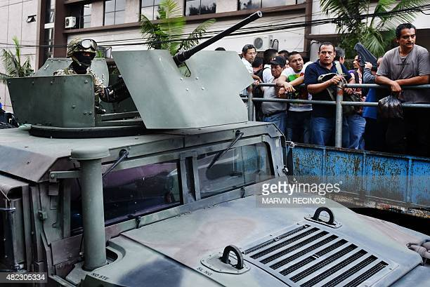Reaction Special Forces guard commuters as they patrol the streets in San Salvador on July 29 during the third day of a transport strike in El...