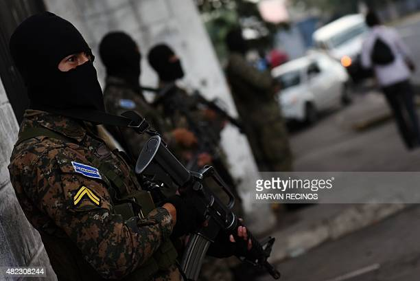 Reaction Special Forces guard patrol the streets in San Salvador on July 29 during the third day of a transport strike in El Salvador over the lack...