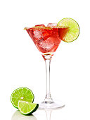 Red martini cocktail with lime