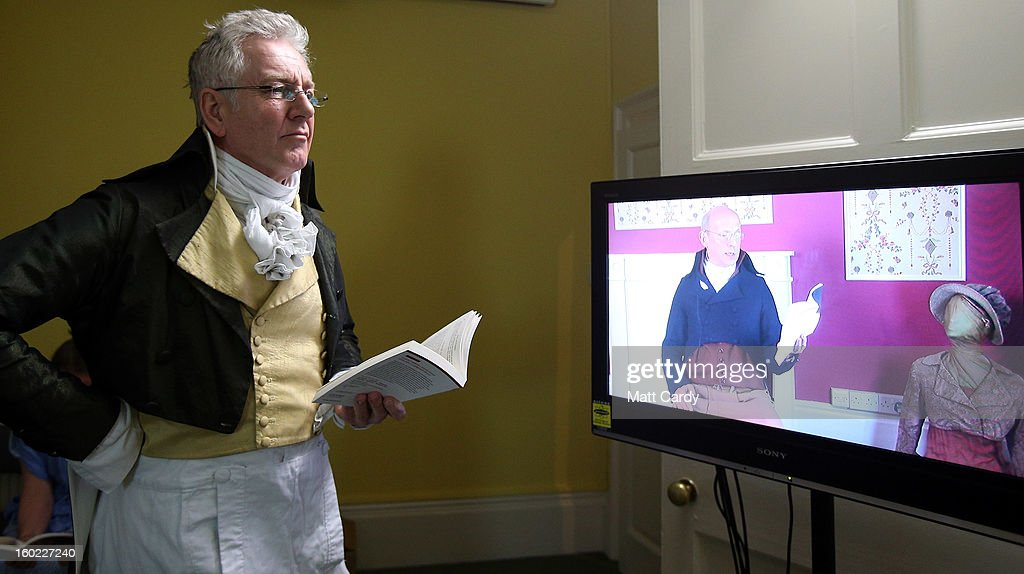 A reader waits as part-time actor Ashley Green (on TV screen) reads chapter ten of Jane Austen's Pride and Prejudice at the Jane Austen Centre on January 28, 2013 in Bath, England. To celebrate the 200th anniversary of the publication, book experts, writers and fans are reading the entire novel in a 12-hour internet broadcast streamed live from the centre which is based in the city where the writer lived from 1801 to 1806.