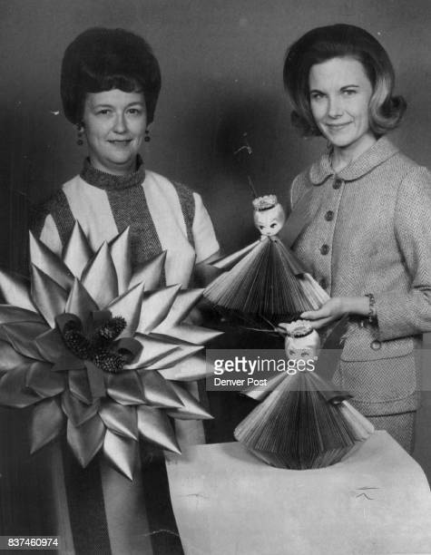 Reader's Digest Angels and IBM Card Wreaths Mrs Donald Evenson left and Mrs E Ross King display wares to be sold at Alpha Phi 'Papers in Vogue' sale...