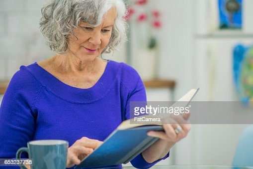 Reading a Book at Home : Stock Photo