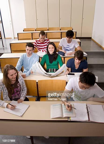 Reading a newspaper in class