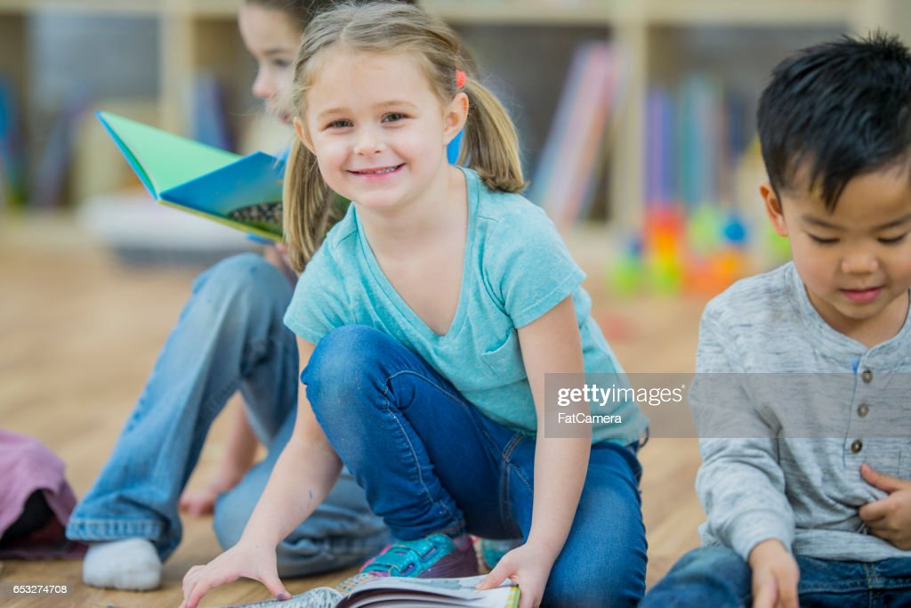 Reading Books Together in Class : Stock Photo