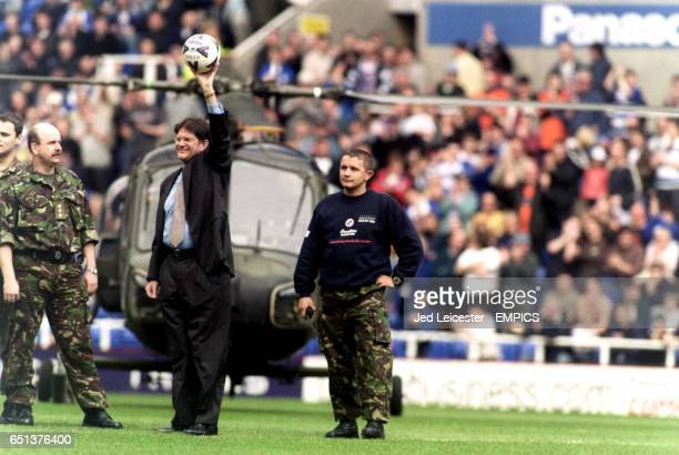 Reading Chairman John Madejski arrives in a helicopter with the matchball