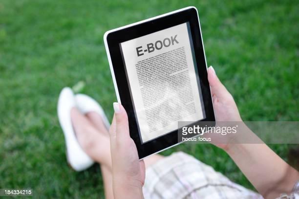 Reading E-book in park