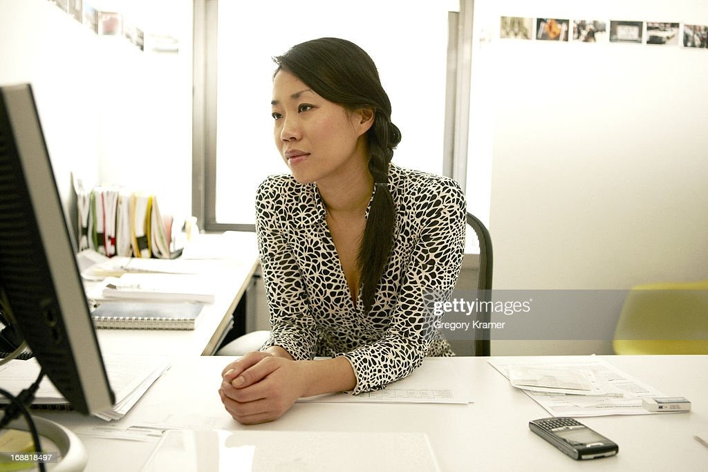 Reading emails at work : Stock Photo