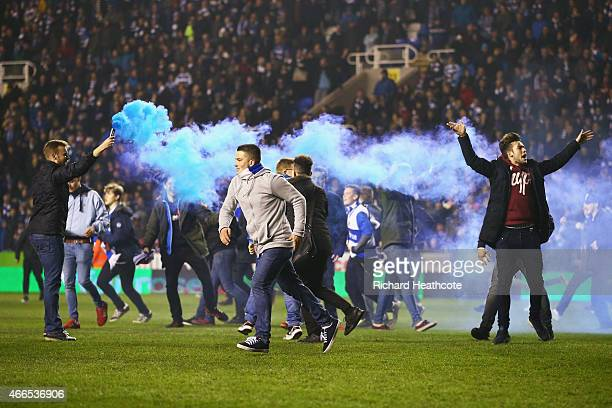 Reading fans celebrate on the pitch after the FA Cup Quarter Final Replay match between Reading and Bradford City at Madejski Stadium on March 16...