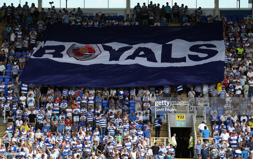 Reading fans fly the flag during the Barclays Premier League match between Reading and Stoke City at Madejski Stadium on August 18, 2012 in Reading, England.
