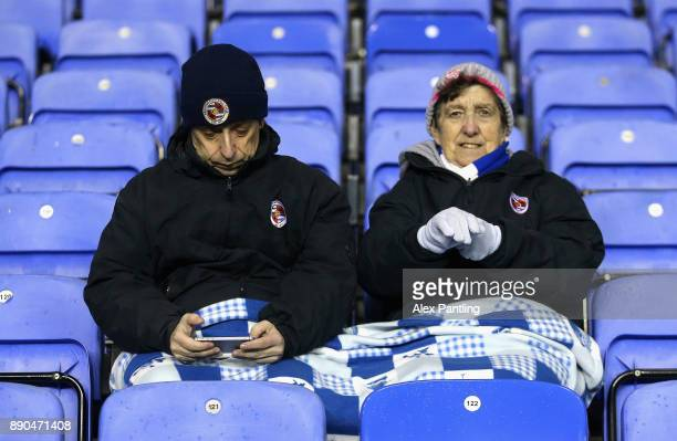 Reading fans keep warm as they await kick off the Sky Bet Championship match between Reading and Cardiff City at Madejski Stadium on December 11 2017...