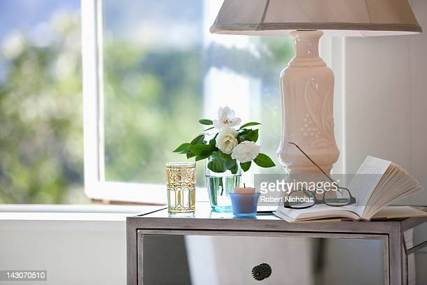 Reading glasses and book on night stand