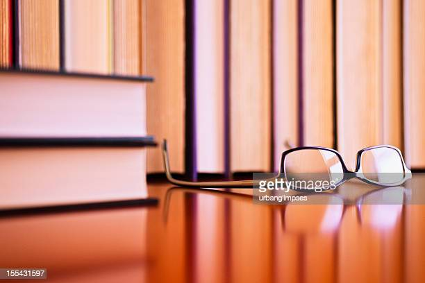 Reading glasses and books on a table