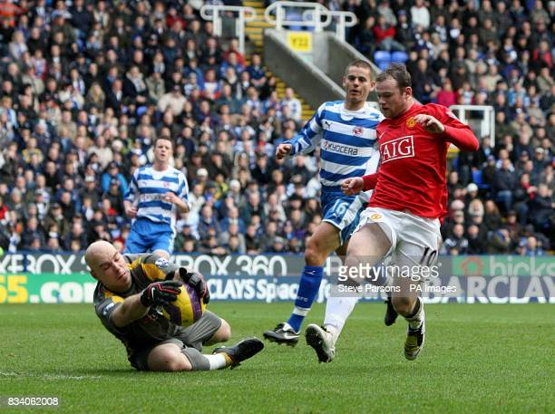 Reading goalkeeper Marcus Hahnemann collects the ball to deny Manchester United's Wayne Rooney