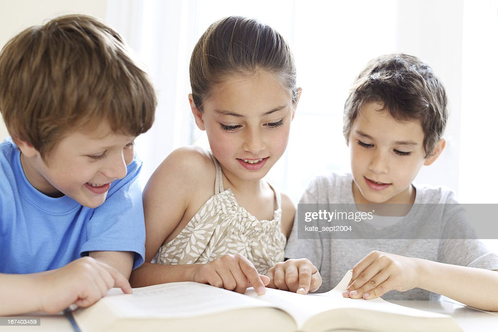 Reading in a classroom : Stock Photo