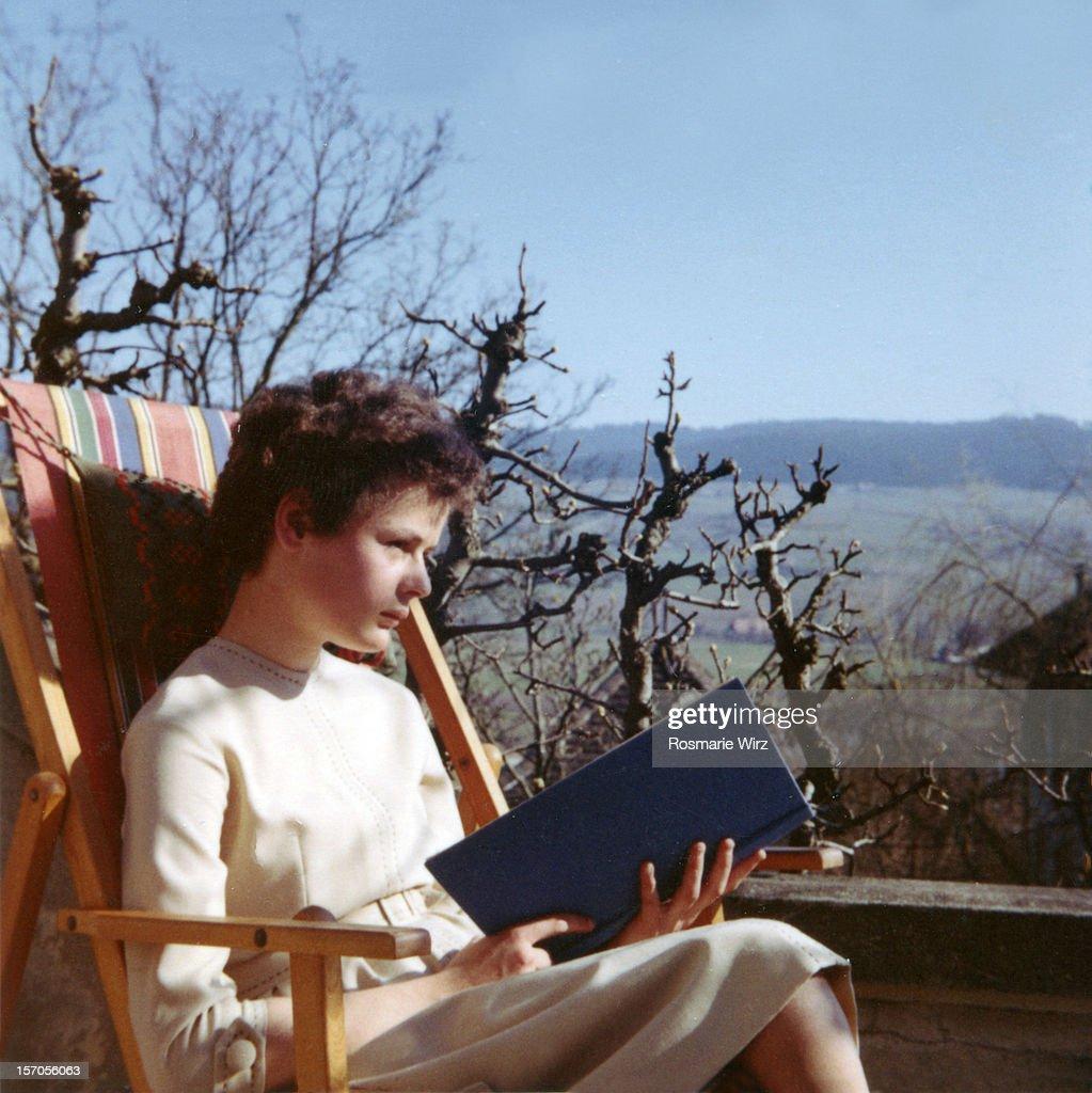 Reading in the garden. : Stock Photo
