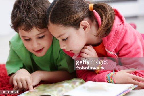 Reading kids : Stock Photo