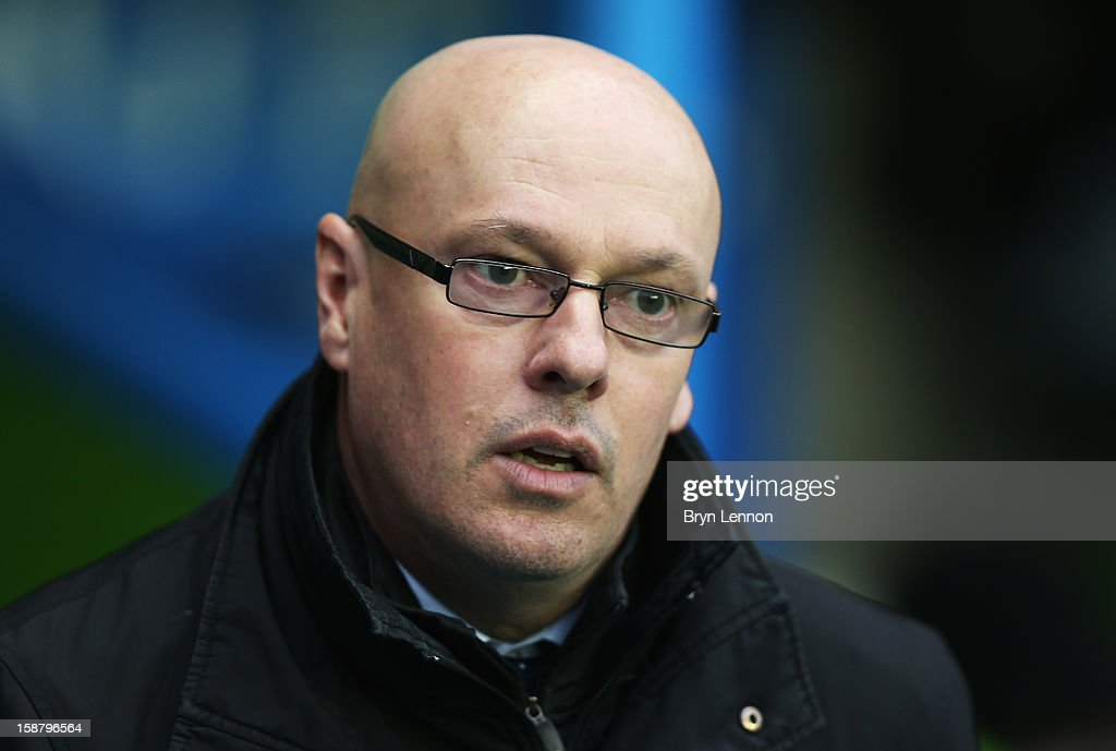 Reading Manager Brian McDermott looks on prior to the Barclays Premier League match between Reading and West Ham United at the Madejski Stadium on December 29, 2012 in Reading, England.