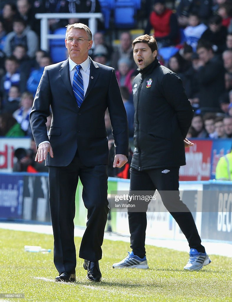 Reading manager Nigel Adkins (L) looks on as Southampton manager Mauricio Pochettino reacts during the Barclays Premier League match between Reading and Southampton at the Madejski Stadium on April 6, 2013 in Reading, England.