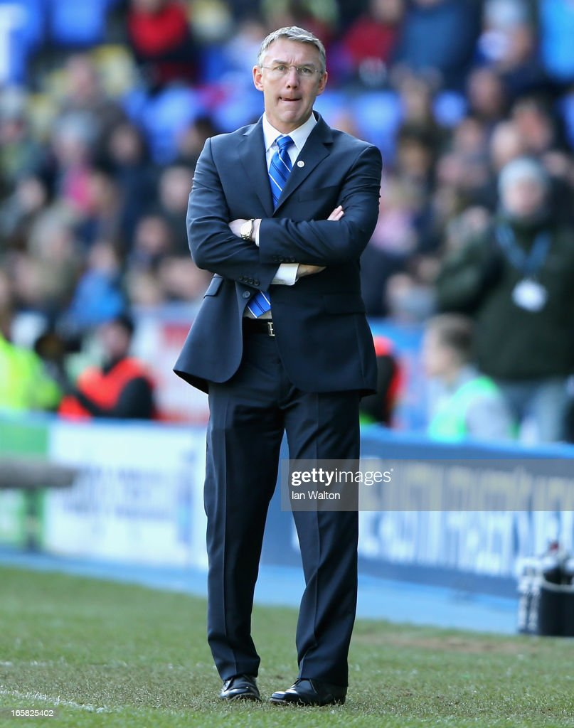 Reading manager <a gi-track='captionPersonalityLinkClicked' href=/galleries/search?phrase=Nigel+Adkins&family=editorial&specificpeople=4015297 ng-click='$event.stopPropagation()'>Nigel Adkins</a> looks on during the Barclays Premier League match between Reading and Southampton at the Madejski Stadium on April 6, 2013 in Reading, England.