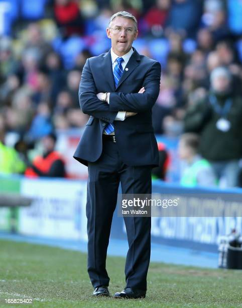 Reading manager Nigel Adkins looks on during the Barclays Premier League match between Reading and Southampton at the Madejski Stadium on April 6...
