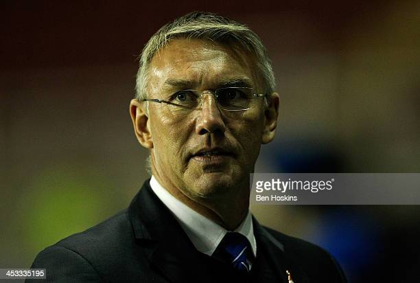 Reading manager Nigel Adkins looks on prior to the Sky Bet Championship match between Reading and Charlton Athletic at Madejski Stadium on December...