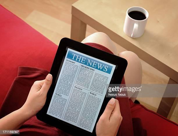 Ler notícias com digital tablet