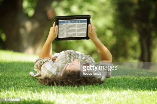 Reading news with digital tablet : Stock Photo
