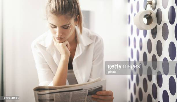 Reading newspapers in toilet.