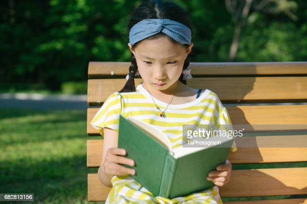 Reading on a bench in the park