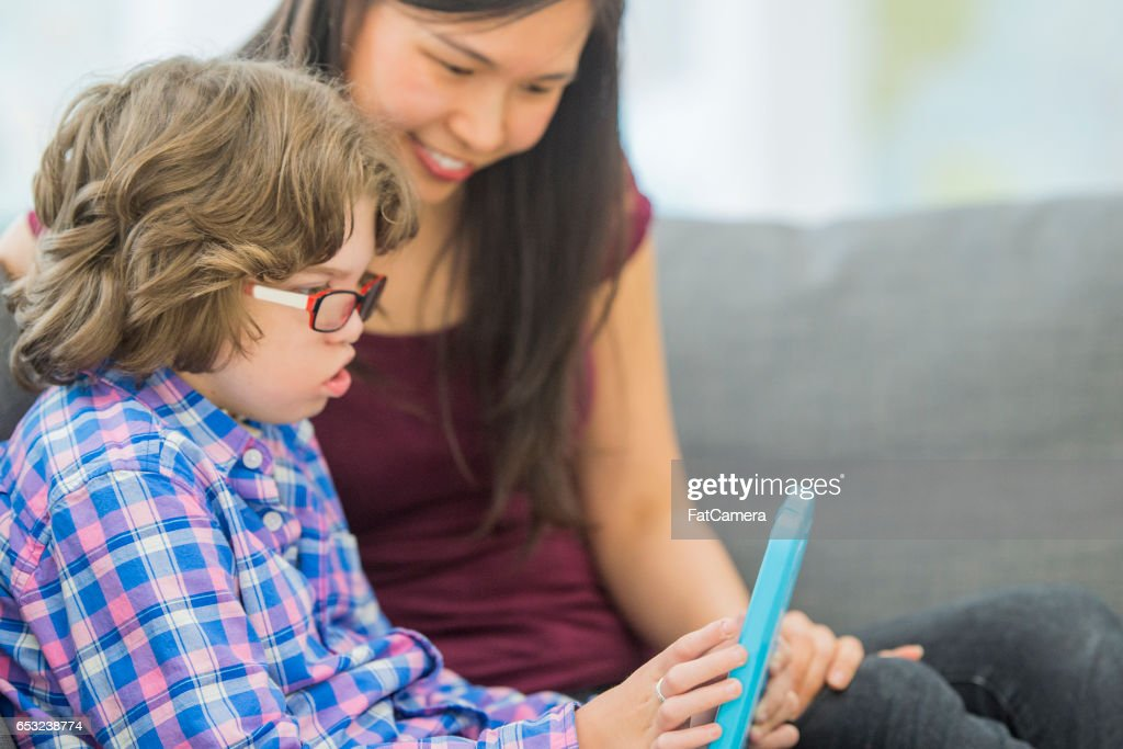 Reading on a Digital Tablet : Stock Photo