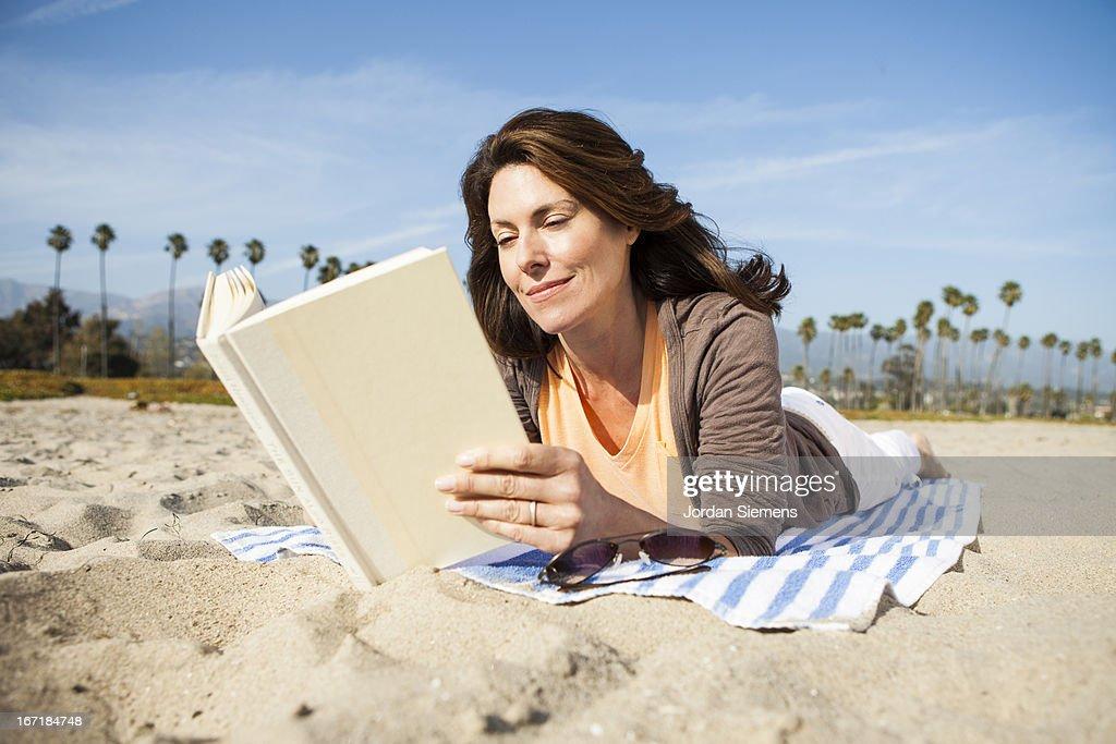 Reading on vacation. : Stock Photo