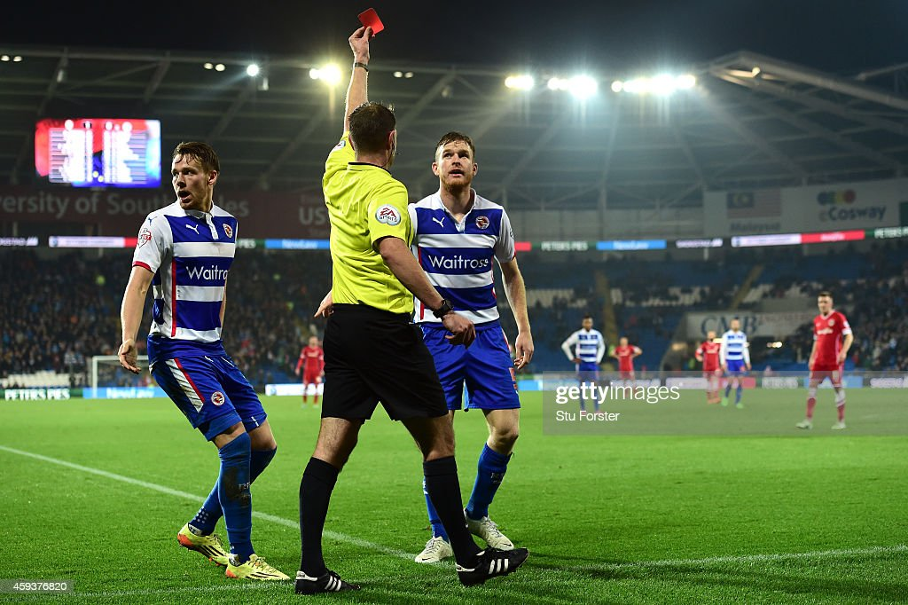 Reading player Alex Pearce is sent off by referee James Linington as Chris Gunter reacts during the Sky Bet Championship match between Cardiff City...