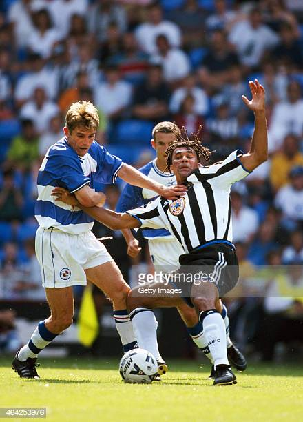 Reading player Phil Parkinson challenges Newcastle United manager Ruud Gullit who had decided to play himself during a pre season friendly at the...