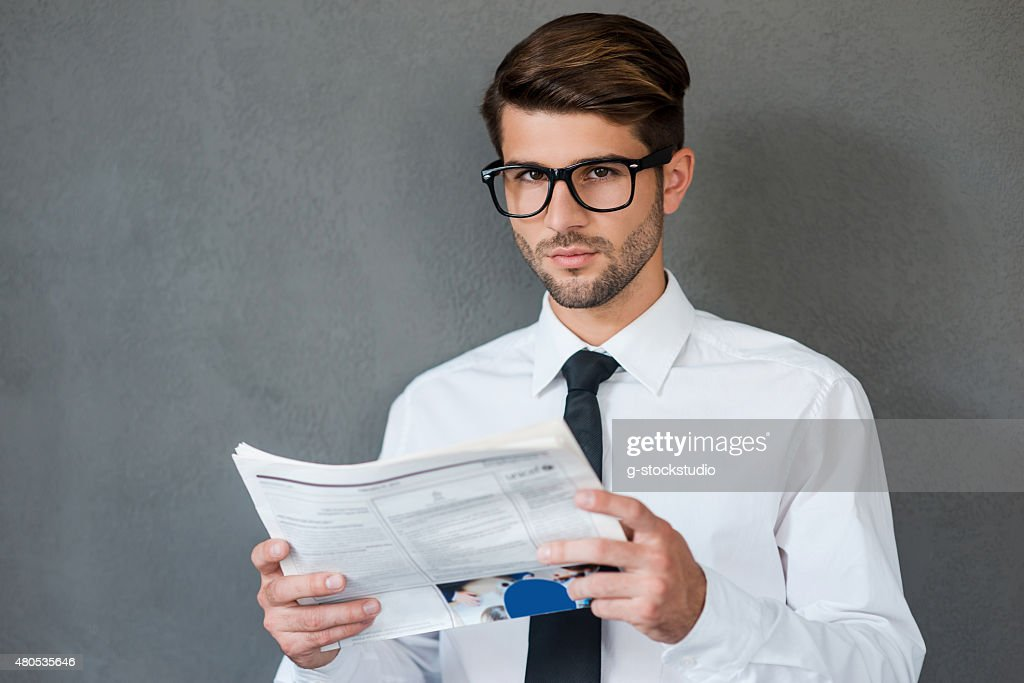 Reading some business news. : Stock Photo