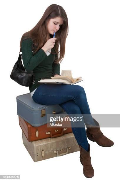 Lettura studente in valigia stack