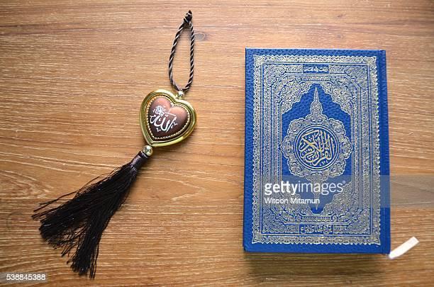 Reading the Holy Quran(Islamic book) in Ramadan night.