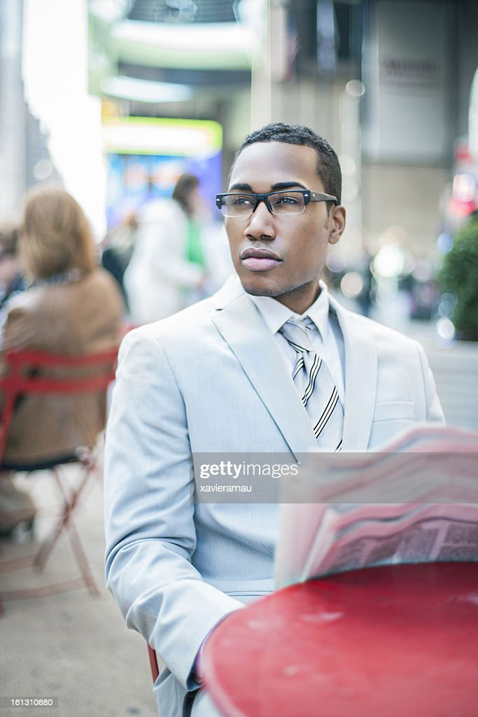 Reading the news at Time Square : Stock Photo