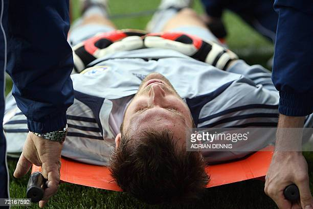 Chelsea goalkeeper Petr Cech lies is evacuated after being injured in the first few minutes of the game against Reading during the Premiership...