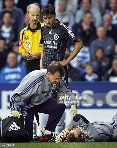 Chelsea's goalkeeper Petr Cech lies injured after an early tackle during the Premiership football match at Madejski Stadium in Reading 14 October...