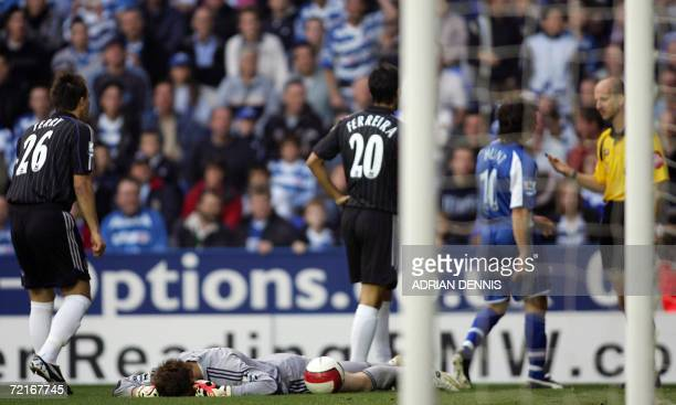 Chelsea's goalkeeper Petr Cech lies injured in the first few minutes of the game after a tackle from Stephen Hunt of Reading during the Premiership...