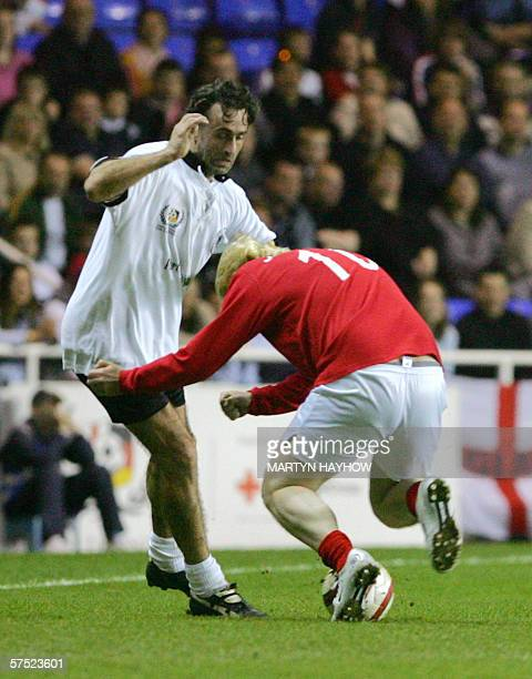 Germany's Maurizio Gaudina is rugby tackled by England's conservative MP Boris Johnson as they take part in the charity match England v Germany...