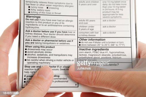 Reading Warning Label on Medicine Package