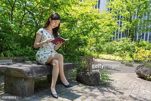 Reading Woman in a Japanese Garden