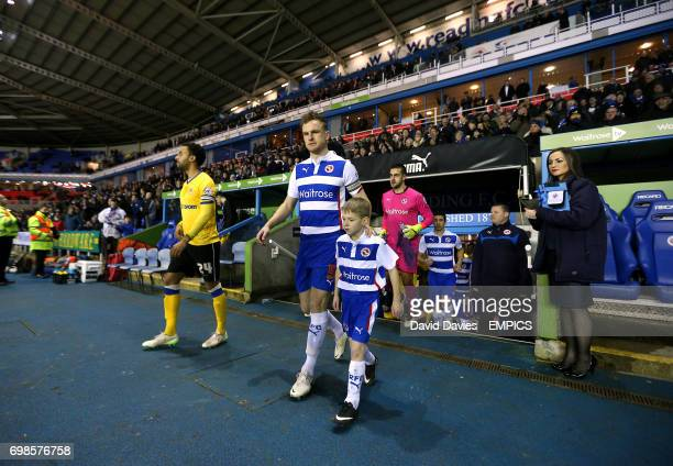 Reading's Alex Pearce and teammates head out of the tunnel onto the pitch