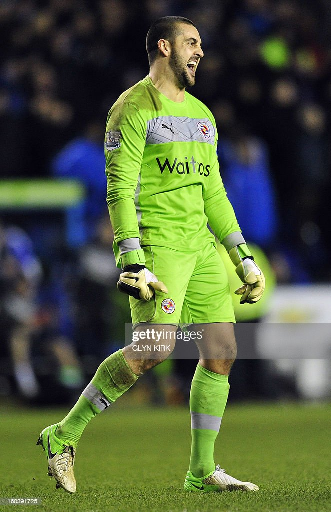 """Reading's Australian goalkeeper Adam Federici celebrates on the final whistle during the English Premier League football match between Chelsea and Reading at the Madejski Stadium in Reading, Berkshire, on January 30, 2013. USE. No use with unauthorized audio, video, data, fixture lists, club/league logos or """"live"""" services. Online in-match use limited to 45 images, no video emulation. No use in betting, games or single club/league/player publications"""