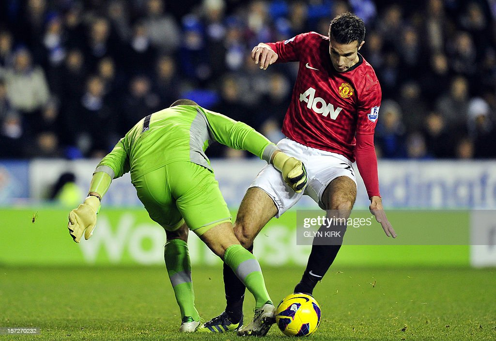 "Reading's Australian goalkeeper Adam Federici (L) challenges Manchester United's Dutch striker Robin Van Persie (R) during the English Premier League football match between Reading and Manchester United at the Madejski Stadium, in Reading, Berkshire, southern England, on December 1, 2012. USE. No use with unauthorized audio, video, data, fixture lists, club/league logos or ""live"" services. Online in-match use limited to 45 images, no video emulation. No use in betting, games or single club/league/player publications"