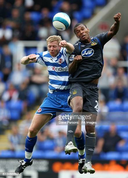 Reading's Brynjar Gunnarsson and Wigan Athletic's Marcus Bent battle for the ball
