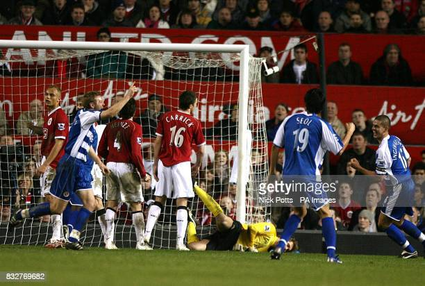 Reading's Brynjar Gunnarsson celebrates his goal as Manchester United goalkeeper Tomasz Kuszczak can only look on