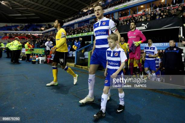 Reading's captain Alex Pearce leads his team out