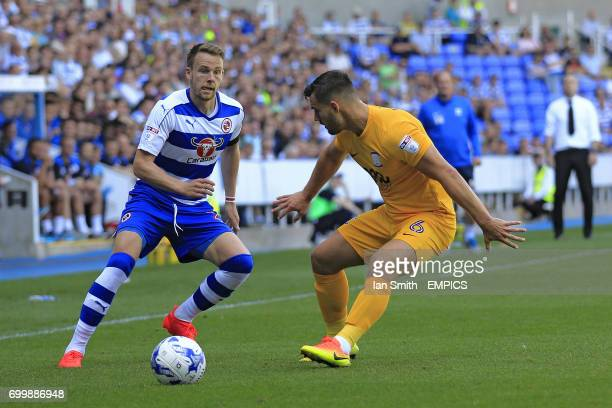 Reading's Chris Gunter and Preston North End's Bailey Wright battle for the ball